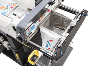 Autobag 850S Mail Order Fulfillment Bagger being filled with a shoe box